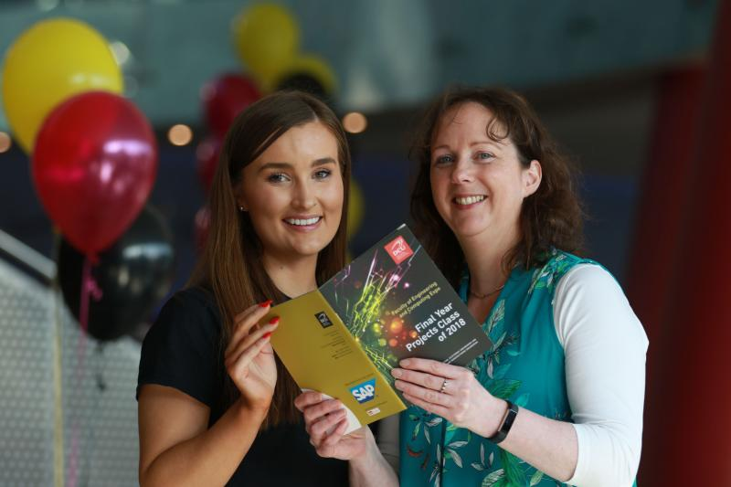 Prof. Lisa Looney and Jessica Hall from SAP read over the Expo Booklet