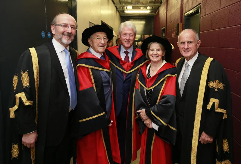 Group photo of President Brian MacCraith, Dr. Martin Naughton, President Bill Clinton and Sr Stanislaus Kennedy
