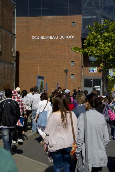 Group of students walking towards DCU Business School