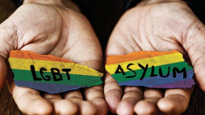 Two open hands draped in a LGBTQ+ ribbon with LGBT on one hand and asylum on the other