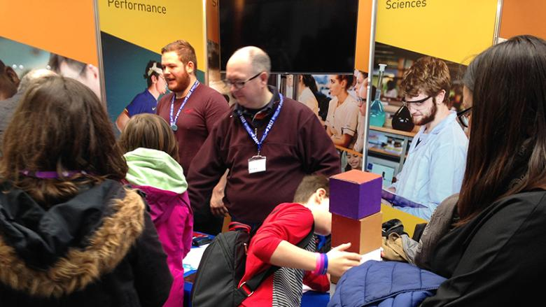 Second level students with mathematical puzzles at BT Young Scientist