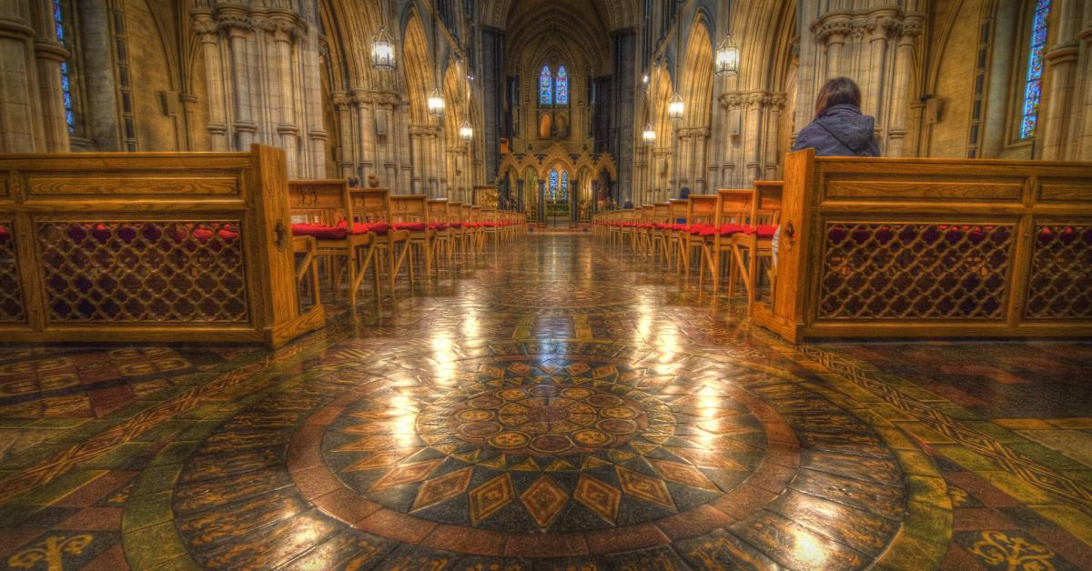 Lone person in prayer at Christ Church Cathedral, Dublin