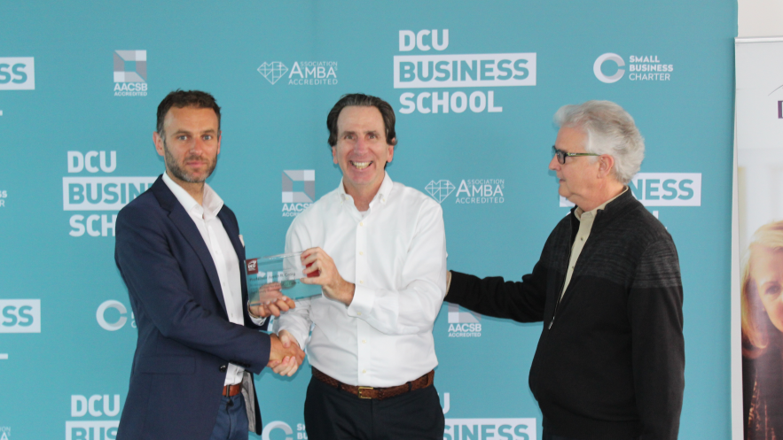 Director Eric Clinton presents Dr Justin Craig with a plaque of honour following fellowship in DCU
